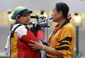 """北京时间2012年7月27日,怀有8个多月身孕的""""超级妈妈""""泰比(Nur Suryani Moham..."""