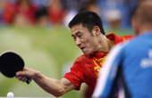 8月21日,在北京奥运会乒乓球男子单打第三轮比赛中,王励勤以4比0轻松战胜波兰选手卢希安・布拉什切克。新华社/摄